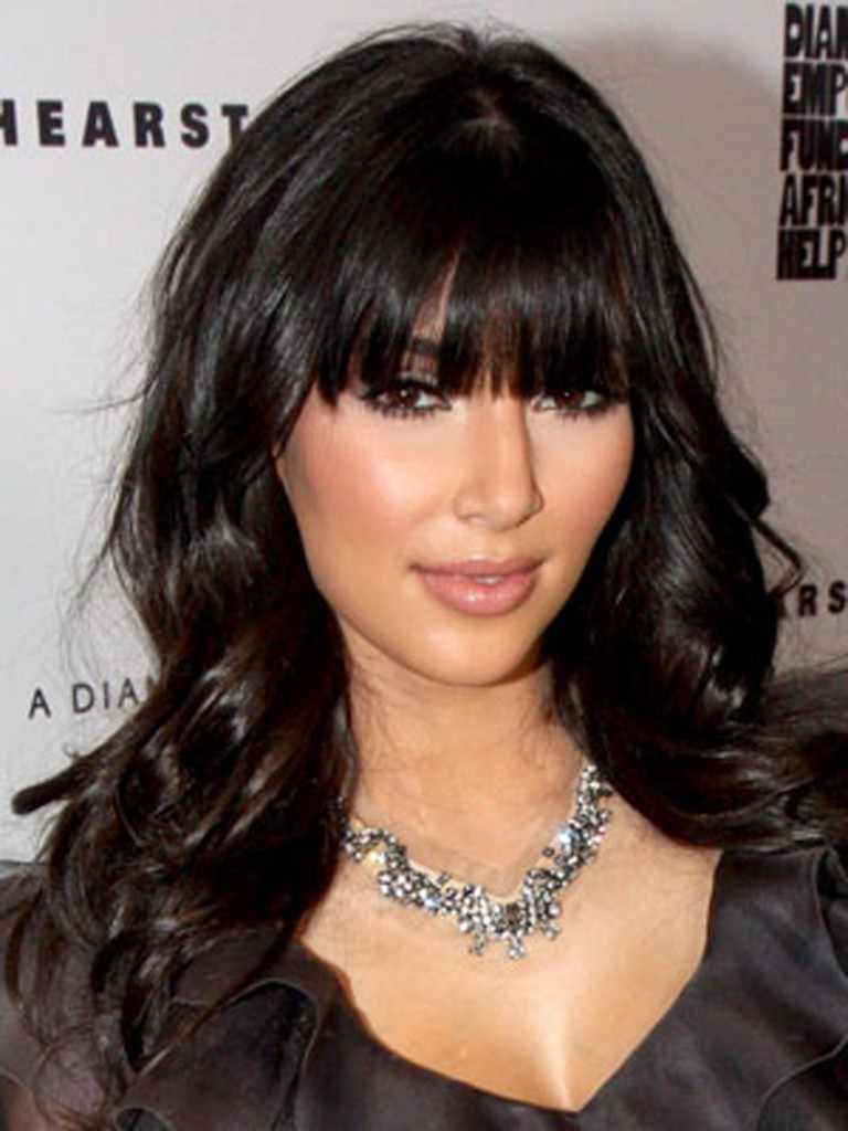 curly-hairstyle-with-bangs-23