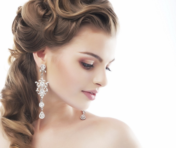 Beautiful Bride with Curly Hair and Jewelery. Sensuality