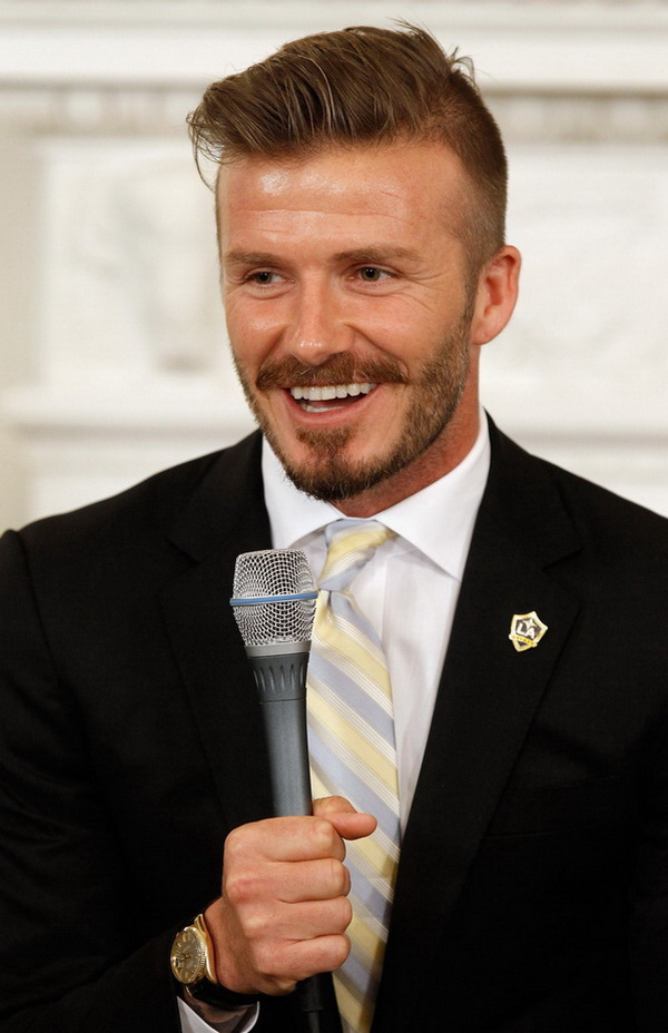 WASHINGTON, DC - MAY 15: Soccer player and L.A. Galaxy midfielder David Beckham answers questions from school-age sports fans in the State Dining Room of the White House May 15, 2012 in Washington, DC. The Major League Soccer champaion L.A. Galaxy were at the White House to be congratulated by President Barack Obama. Part of the first lady's Let's Move initiative, the program was supposed to be an outdoor soccer clinic but a forecast for wet weather forced them indoors. (Photo by Chip Somodevilla/Getty Images)