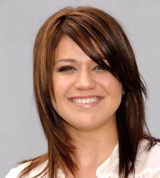 medium hairstyles with bangs and layers photo - 1
